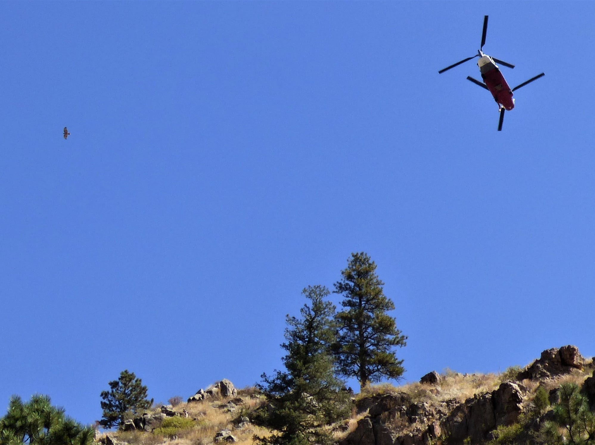 Reader Kristen Peterson, who lives near the Seaman Fire, provided this photo of a helicopter working the fire.