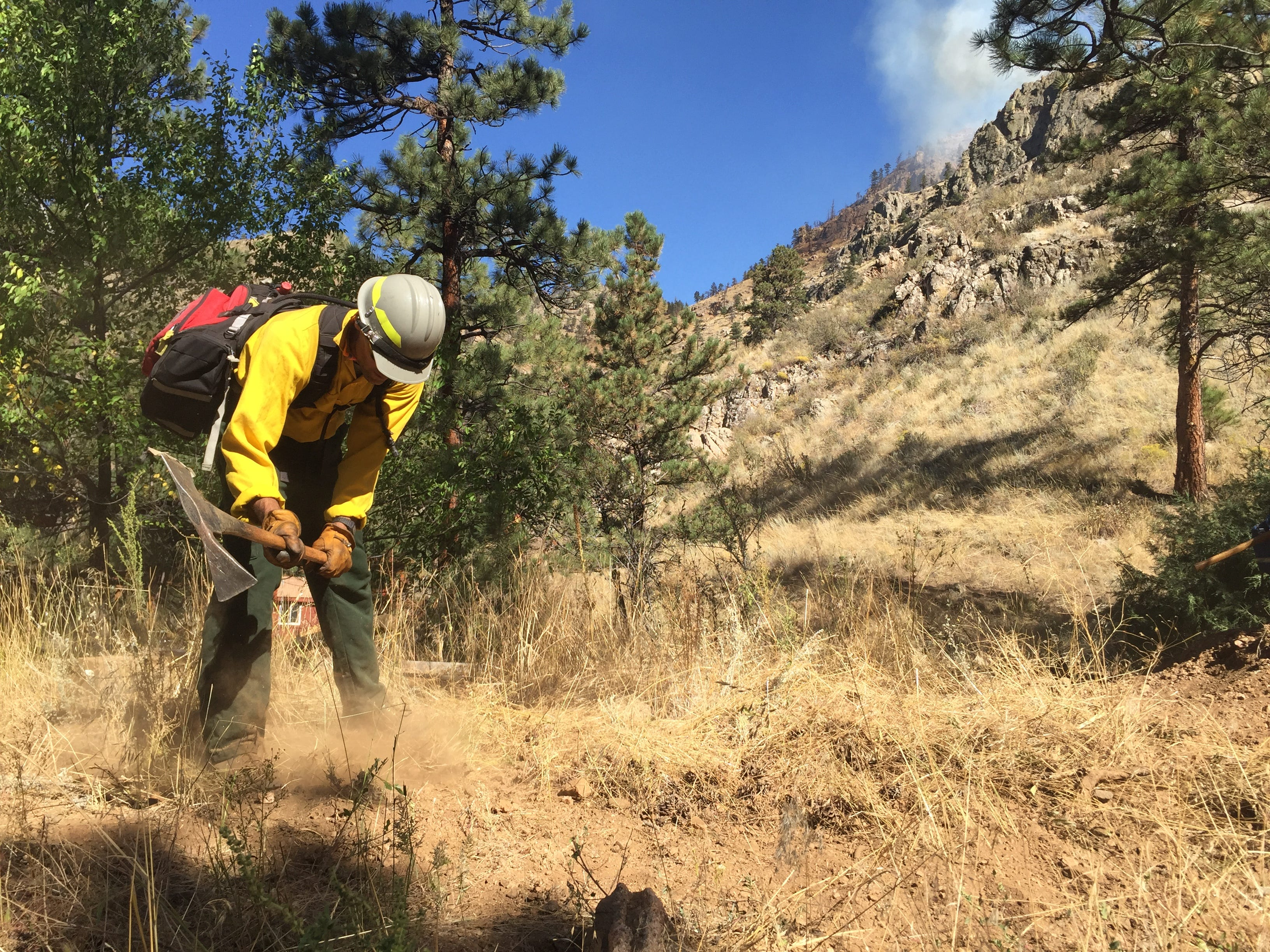 Crews work on a fire line as they work to protect homes on Smith Bridge Road from the Seaman Fire Wednesday.