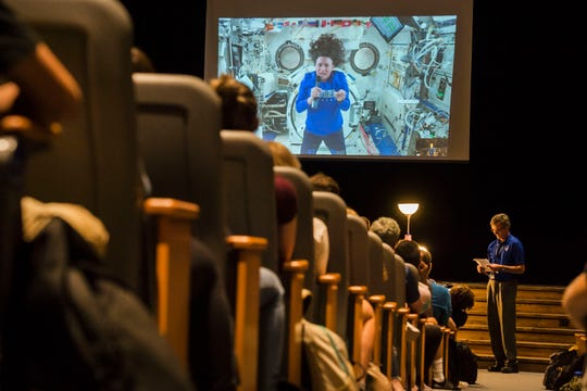 Poudre High School alumni and United States astronaut currently onboard the International Space Station Serena Au–—n-Chancellor skypes in to an assembly to answer questions from current Poudre High students while current teacher Tim Lenczycki looks on, as seen on Wednesday, Sept. 12, 2018, in Fort Collins, Colo.
