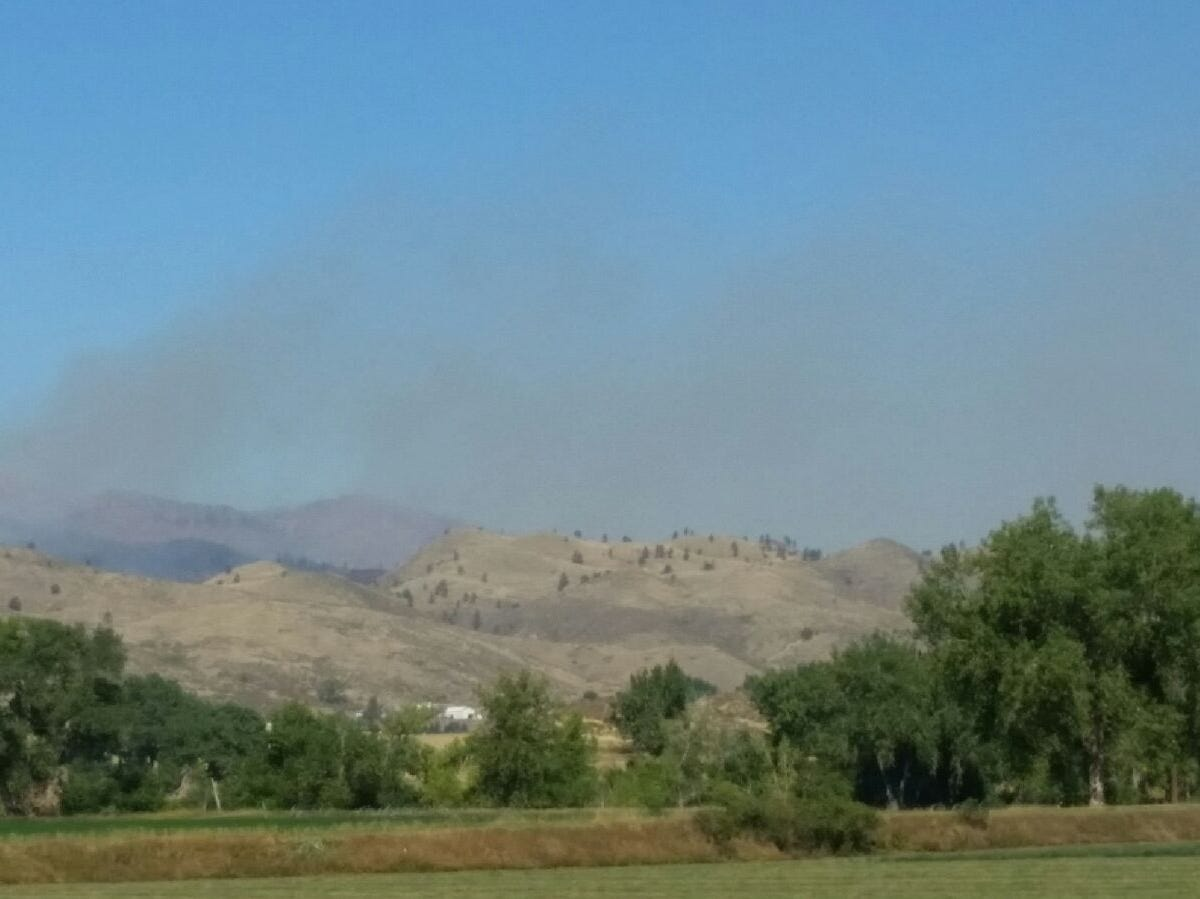 Smoke is visible from the Seaman Fire in Poudre Canyon on Wednesday morning