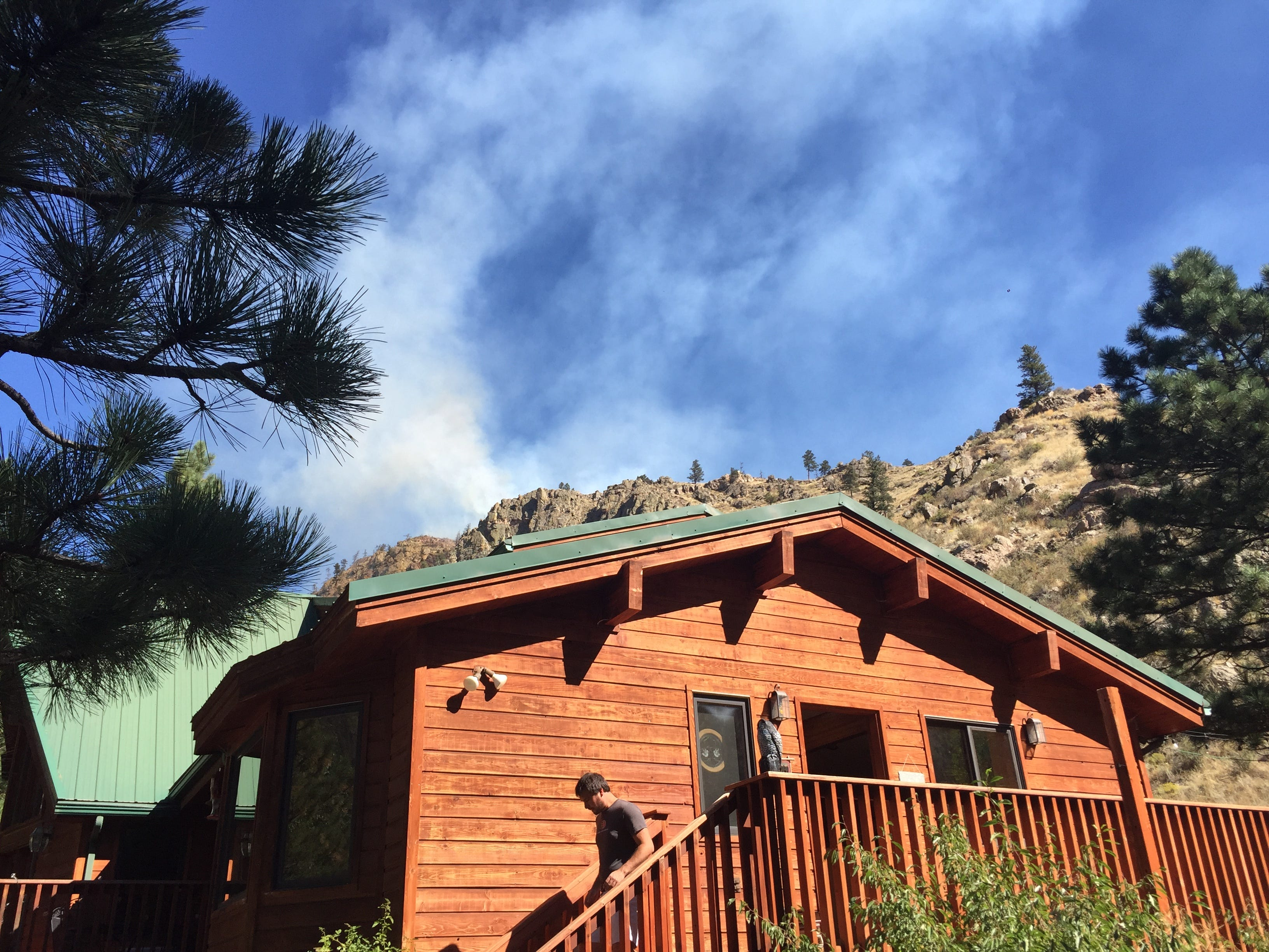 Smoke from the Seaman Fire is seen from this home on Smith Bridge Road Wednesday.