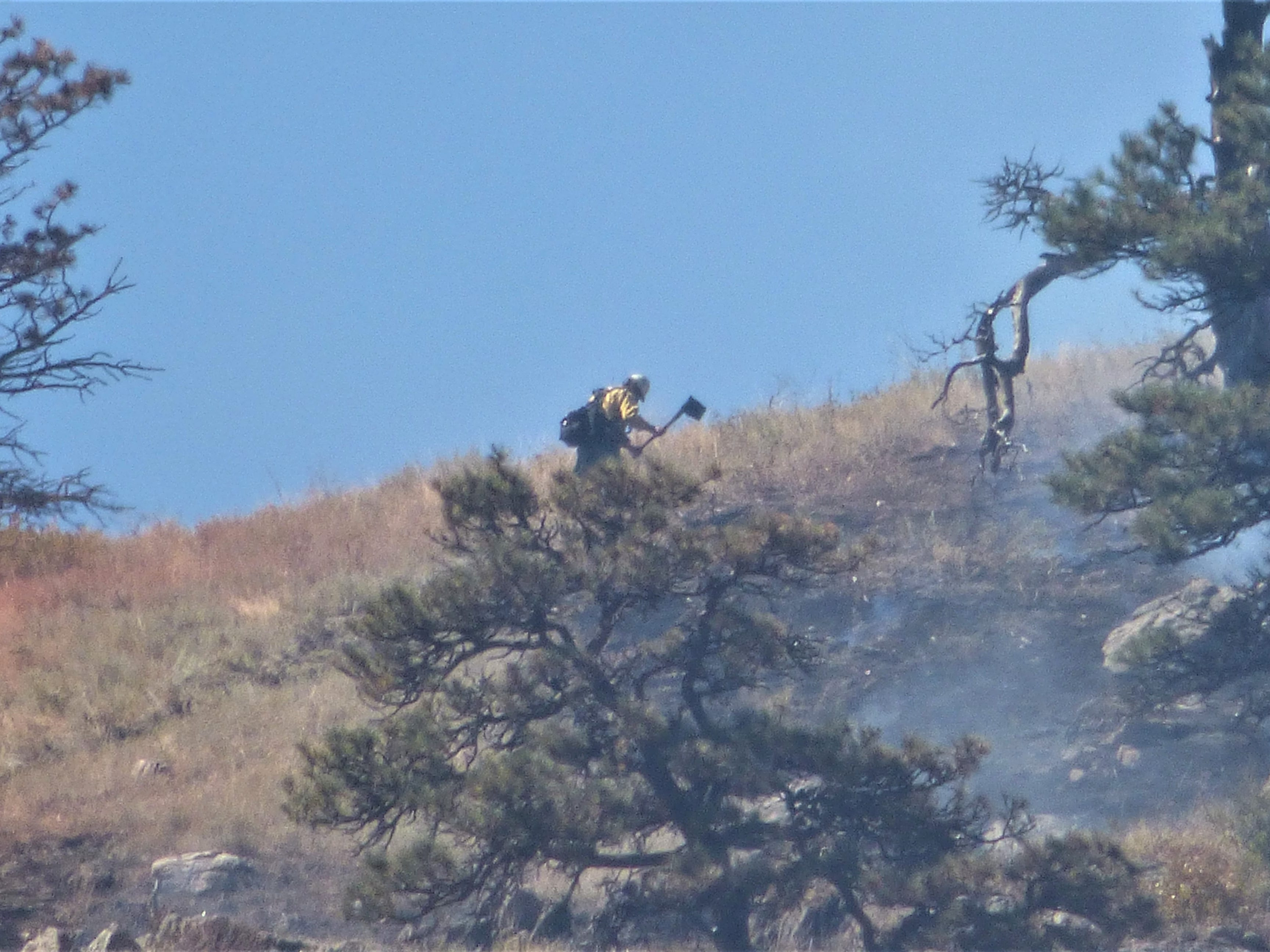 Reader Kristen Peterson, who lives near the Seaman Fire, provided this photo of a firefighter working the fire.