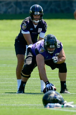 Former CSU long-snapper Trent Sieg snaps the ball to quarterback Joe Flacco during a practice at the Baltimore Ravens training camp this summer. Sieg signed Wednesday with the Oakland Raiders and will be that team's long-snapper Sunday, when they visit Denver to play the Broncos.