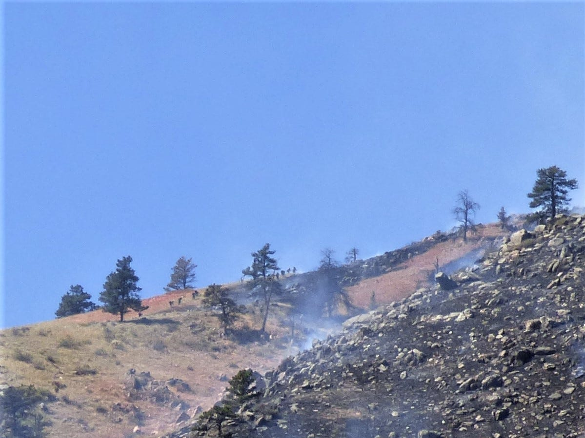 Reader Kristen Peterson, who lives near the Seaman Fire, provided this photo of the smoldering fire.