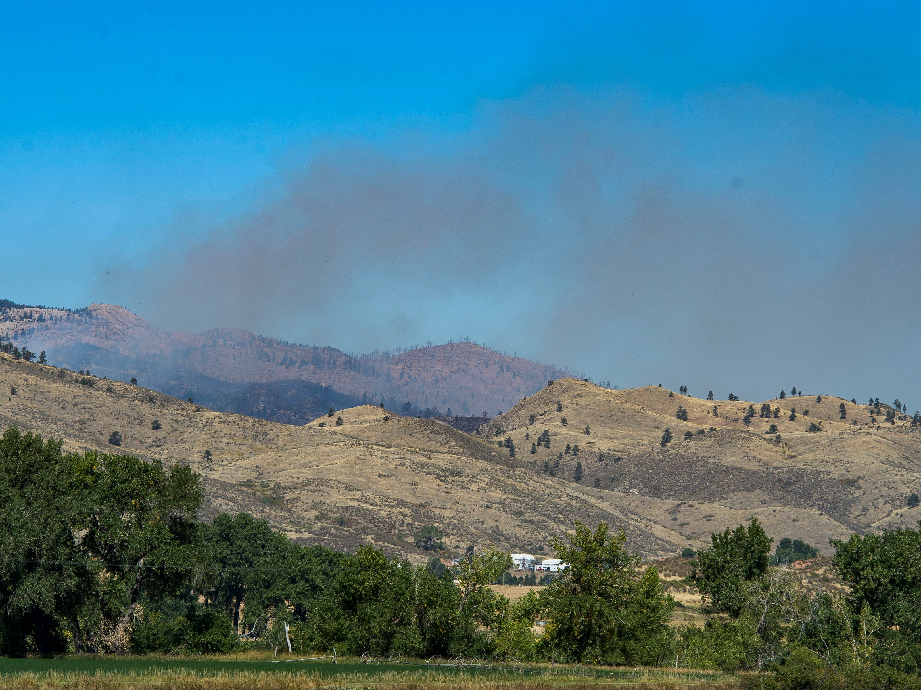 Smoke from the Seaman fire rises from Poudre Canyon on Wednesday, Sept. 12, 2018, in Larimer County, Colo.