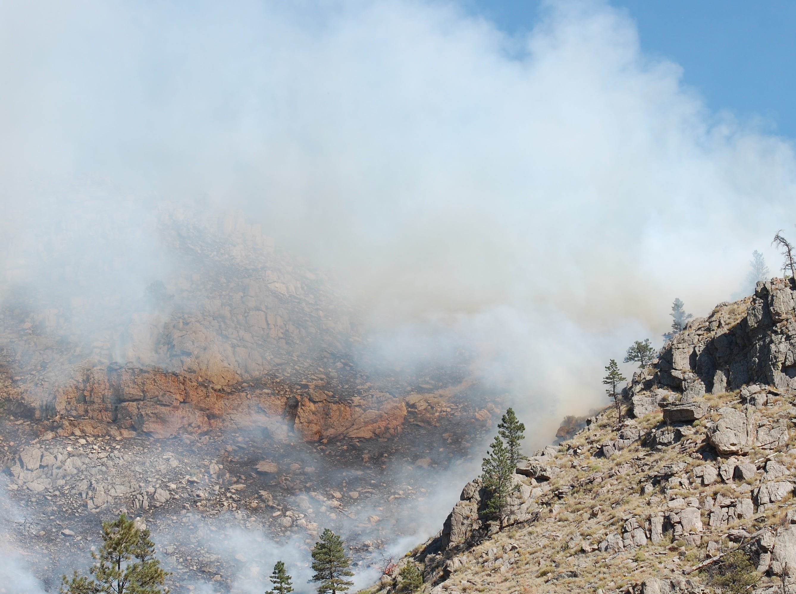 Smoke rises from the Seaman Fire as it works its way to Colorado Highway 14 just west of Gateway Park in the Poudre Canyon.