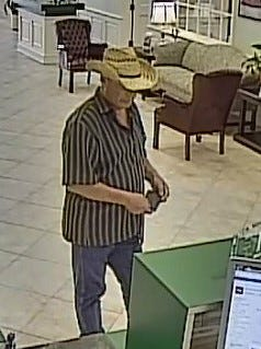 Edward J. Reynolds,  suspected by the FBI in the armed robbery of four Southwest Florida banks since January, was shot and killed in Kentucky on Tuesday when police tried to apprehend him. This photo was taken during a robbery at the Fifth Third Bank on Del Prado Boulevard in Cape Coral.