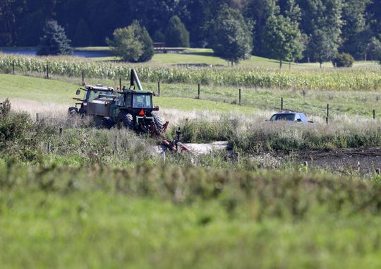 Authorities are working to clean up 300,000 gallons of manure that spilled into Silver Creek on Monday after a holding tank valve failed at the Phil Robertson farm on County E in Oneida.
