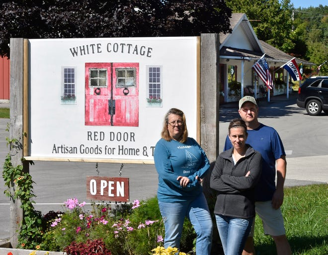 "White Cottage Red Door owners Kevin and Lisa Howard, back, along with Jessica Hadraba, front, and husband Chris Hadraba, not pictured, are challenging town of Gibraltar's ordinance ban on food trucks. Their new food truck was parked next to the retail store at 8813 State 42, just south of Fish Creek, serving ""all things cherry.''"