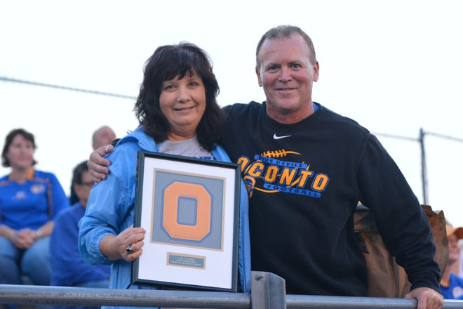 Carla Ruechel, pictured with Oconto Athletic/Activities Director Rick Sherman, was recently honored as the Blue Devil Distinguished service award recipient for 2018-19. Ruechel performed numerous duties for Oconto athletics and activities over the years, including assisting current and previous Oconto coaches and student athletes and serving as member of the school's Booster Club for the past 12 years. Ruechel also served on the Oconto Unified School District Board of Education for several years, implementing the Nutrition-Fitness Committee. Ruechel's devoted service to the community made her a worthy selection for the honor, Sherman said.