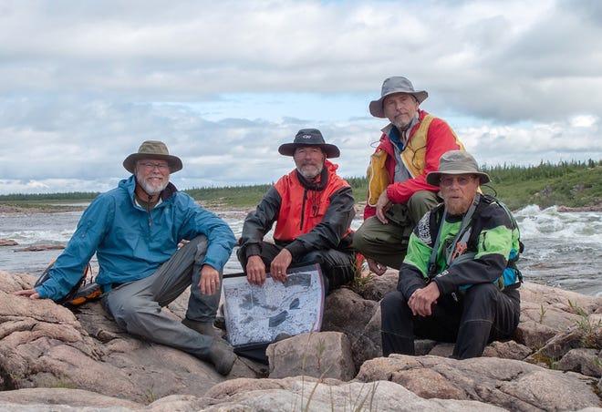 From left, modern voyageurs Mark Borchardt, John Sperry, Mason Reid and Dan Burgette pause for a photo along the Tha-Anne River below Thuchonili Lake near Hudson Bay.