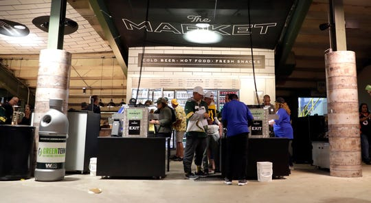 Fans use one of three grab-and-go concession stands the Green Bay Packers are testing at Lambeau Field during the Packers-Chicago Bears game on Sept. 9, 2018.