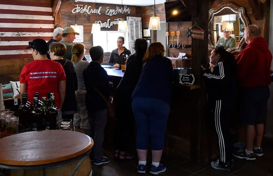 Jessica Hadraba hosts passengers of one of Door County Trolley's Premier Wine Tours Monday at the White Cottage Red Door in the town of Gibraltar on Monday.