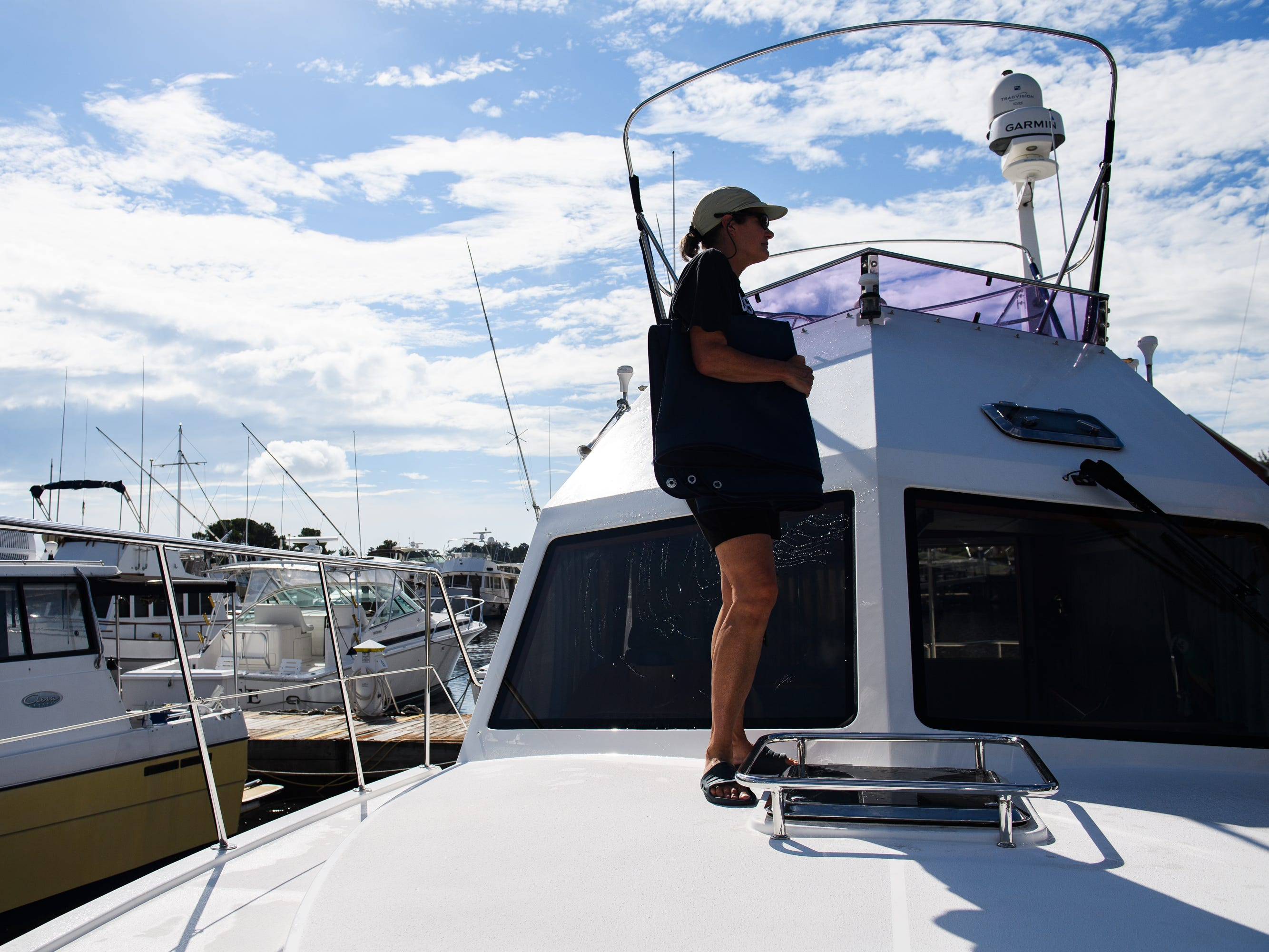 Barbara Coates finishes up preparing her boat for Hurricane Florence at the Lightkeepers Marina in North Myrtle Beach on Wednesday, Sept. 12, 2018.