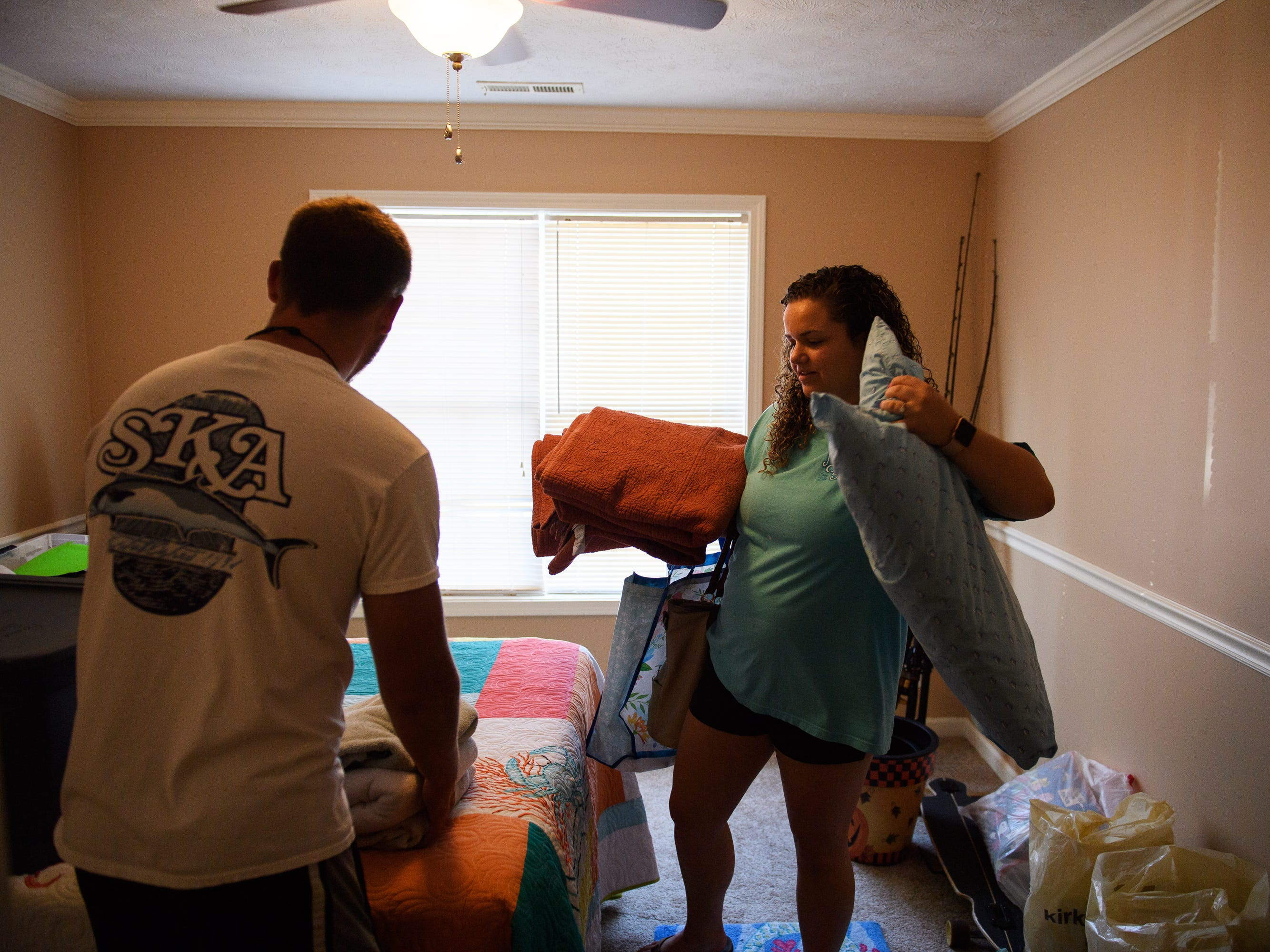 North Myrtle Beach residents Karly Suggs and Jesse Prince pack up their belongings as they prepare to evacuate their home ahead of Hurricane Florence on Wednesday, Sept. 12, 2018.