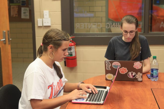 Clemson students Katherine Cupp and Hannah Abee assist in the Social Media Listening Center's efforts for Hurricane Florence.