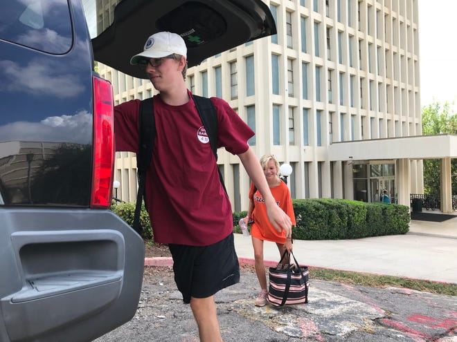 Students at the University of South Carolina pack up Wednesday, Sept. 12, 2018, to head home in Greenville late Wednesday morning after the announcement that classes are canceled through Saturday.