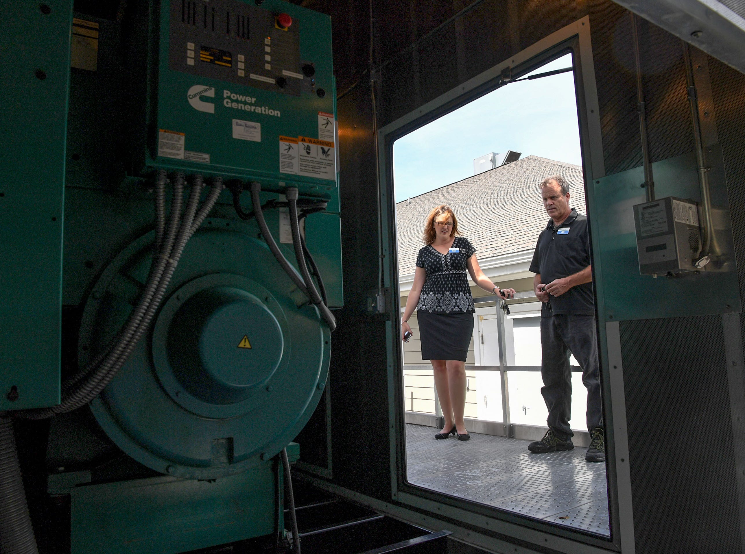 Bonnie Skobel, left, an administrator at the Trinity Grove Nursing Home in Wilmington, North Carolina, looks at a 750 Kilowatt generator with Pete Nero, the director of facilities, on Wednesday. Hurricane Florence is expected to reach Wilmington on Thursday night and Skobel said the home is ready for it. (Ken Ruinard / Greenville News / Gannett USA Today Network / 2018 )