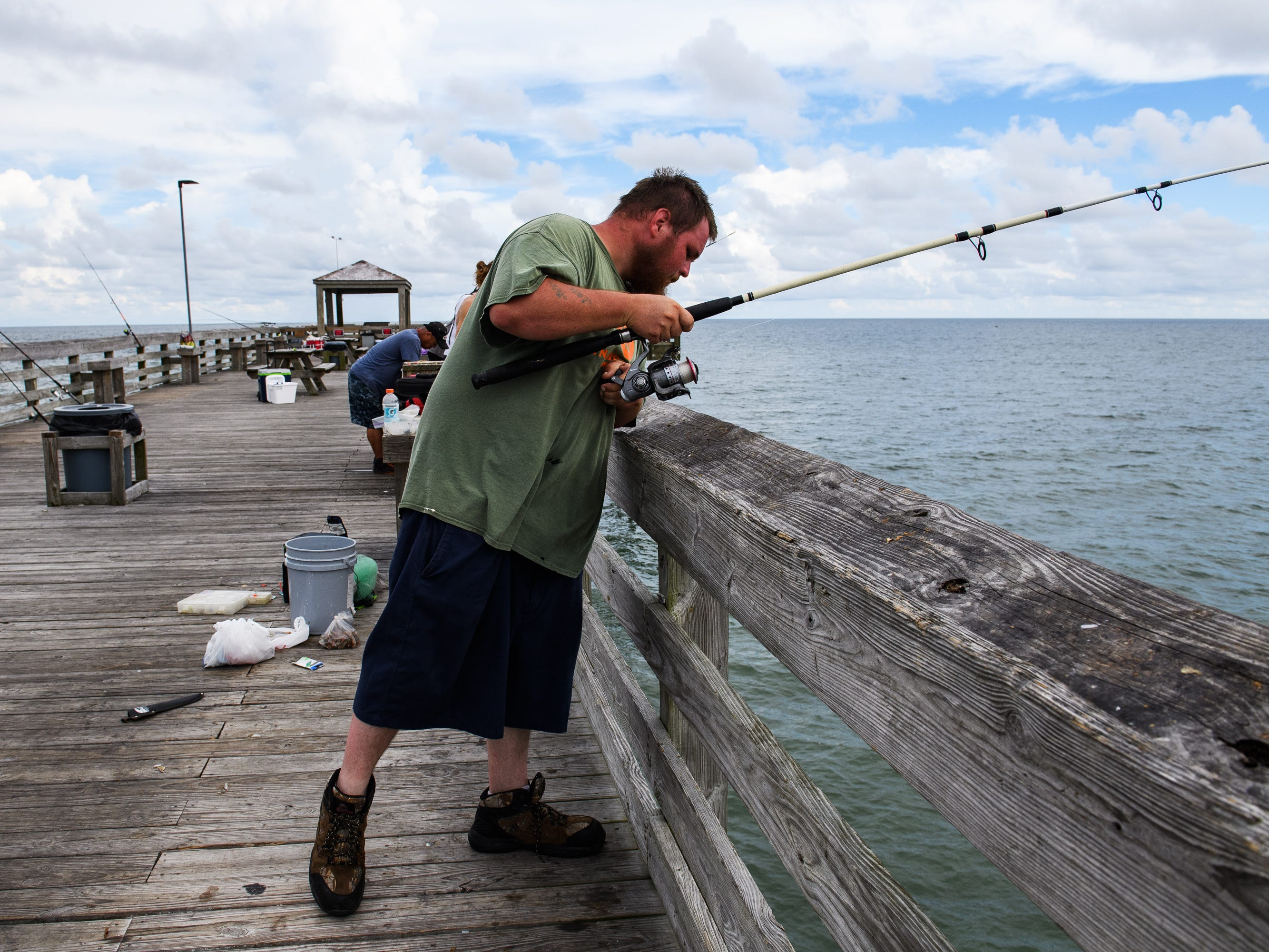 Randy Abercrombie of Lexington, S.C. fishes on the Second Avenue Pier in Myrtle Beach on Tuesday, Sept. 11, 2018. Abercrombie and his family came to Myrtle Beach for vacation but will be evacuating ahead of Hurricane Florence's arrival.