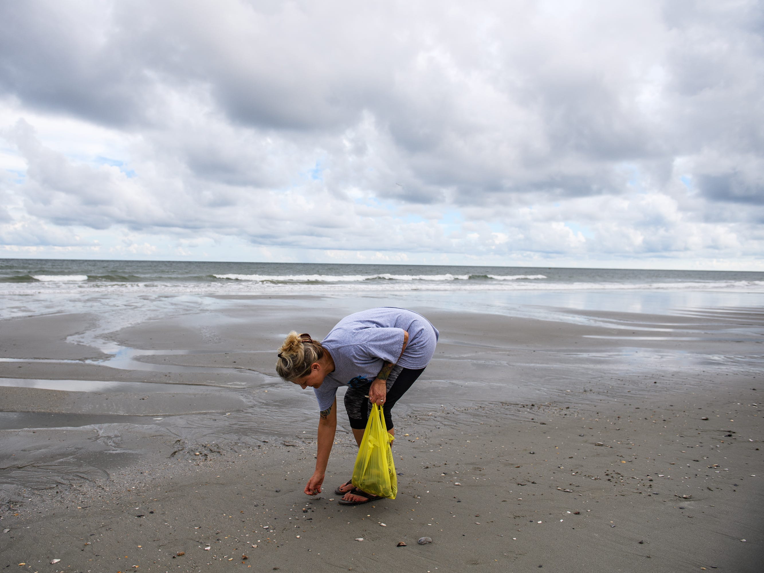 Candace Williams looks for seashells at Myrtle Beach on Tuesday, Sept. 11, 2018, days before Hurricane Florence is expected to hit the area. Williams and her family are still waiting to see how Hurricane Florence progresses, but will most likely leave if it is expected to be a category 3 storm by the time it hits Myrtle Beach.