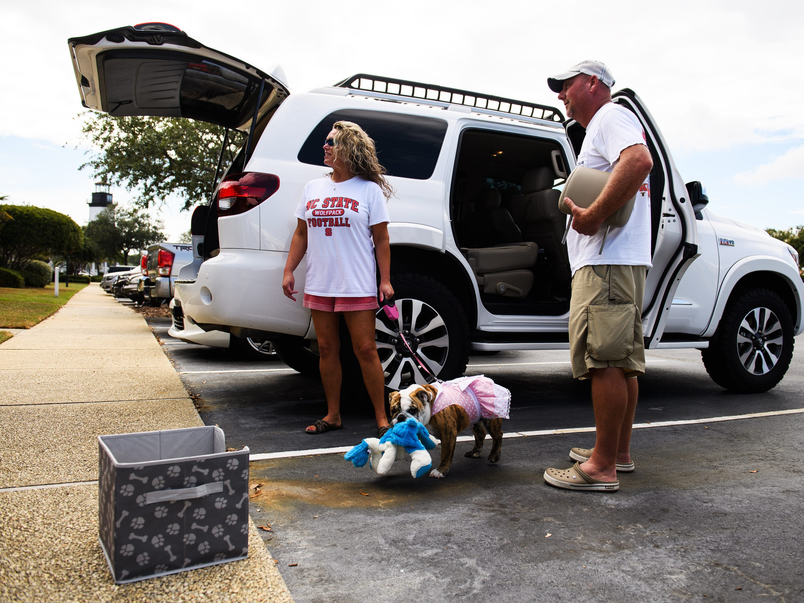 Billy and Stacy Prince and their dog Dixie begin packing up their vehicles to evacuate their North Myrtle Beach home on Wednesday, Sept. 12, 2018. Billy Prince, who grew up in the area, said he stayed for past hurricanes but didn't want to take the risk with Hurricane Florence.