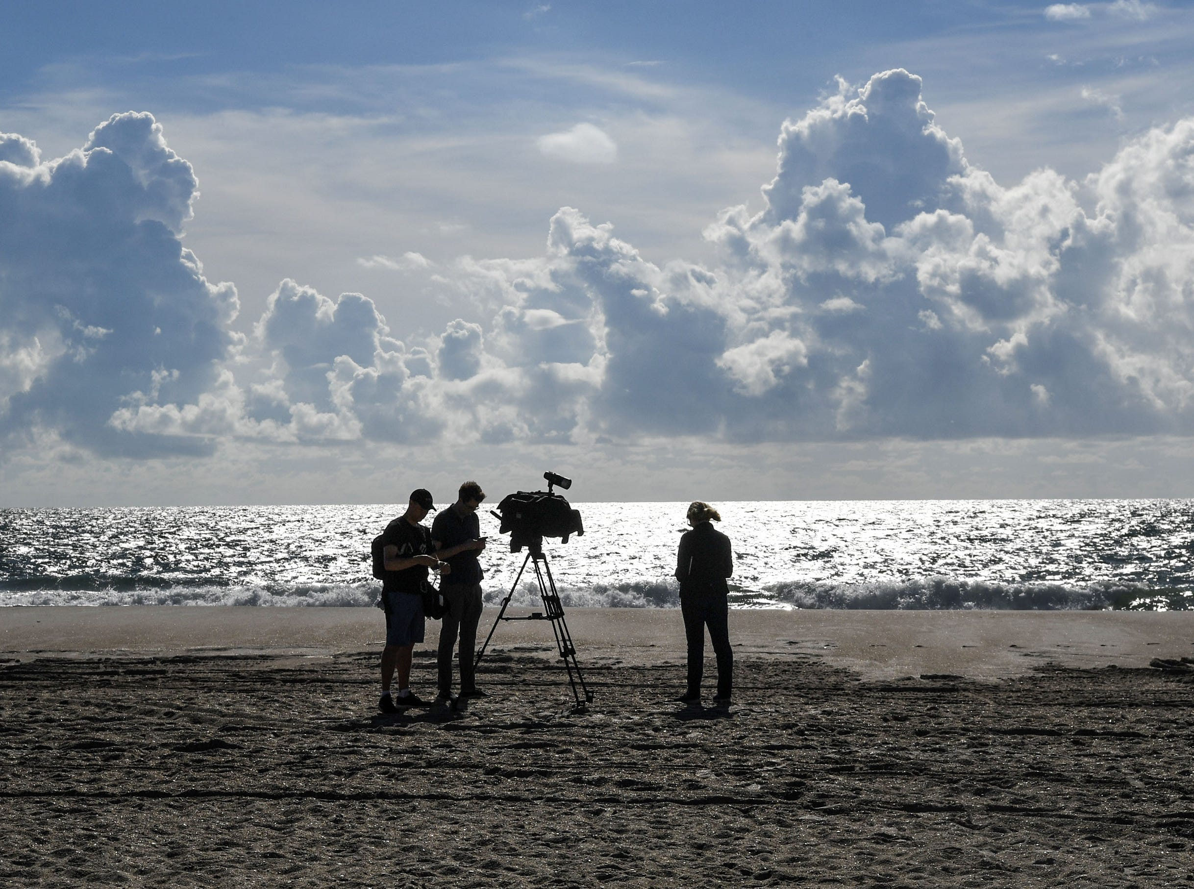 A news outlet pauses between recording at Wrigtsville Beach in Wilmington, North Carolina on Wednesday, September 12, 2018.  (Ken Ruinard / Greenville News / Gannett USA Today Network / 2018 )