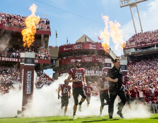 Sep 8, 2018; Columbia, SC, USA; South Carolina Gamecocks players led by South Carolina Gamecocks head coach Will Muschamp make their on-field entrance before their game against the Georgia Bulldogs at Williams-Brice Stadium. Mandatory Credit: Jeff Blake-USA TODAY Sports