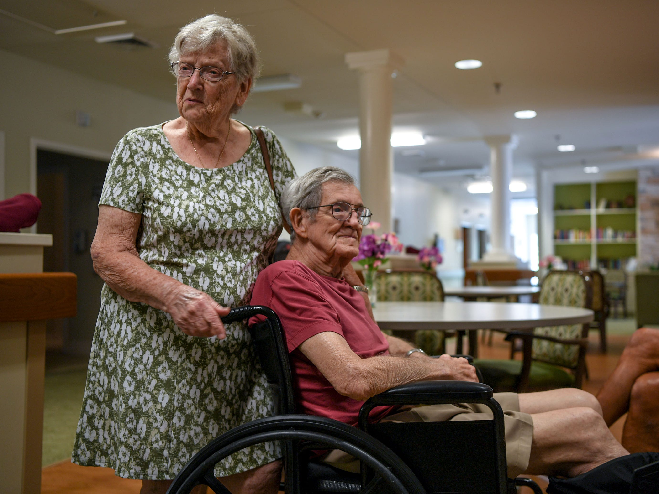 Kay Torrens, left, stands with her husband Leo Torrens before leaving him at the Trinity Grove Nursing Home in Wilmington, North Carolina on Wednesday. Hurricane Florence is expected to reach Wilmington on Thursday night. (Ken Ruinard / Greenville News / Gannett USA Today Network / 2018 )