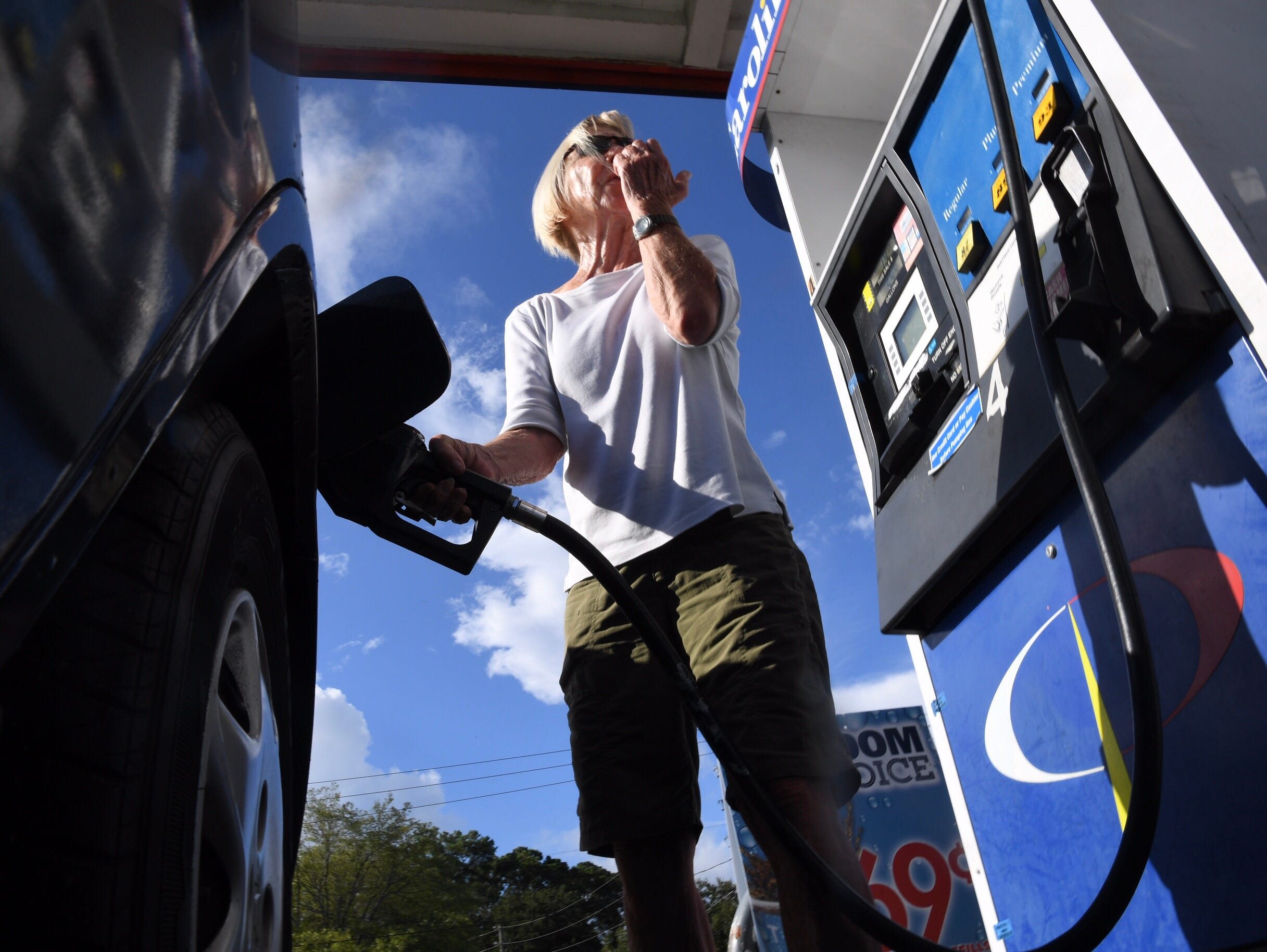 Margie Garrabrand of Wilmington, N.C.,  tops off her vehicle's gas tank on Wednesday, Sept. 12, 2018, in preparation for Hurricane Florence's landfall. She planned to stay put.