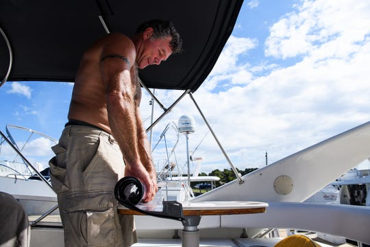 Masten Cloer prepares his boat for Hurricane Florence at the Lightkeepers Marina in North Myrtle Beach on Wednesday, Sept. 12, 2018. Cloer, who lives in North Carolina, said he drove down to protect his new boat and will be staying in it during the hurricane.