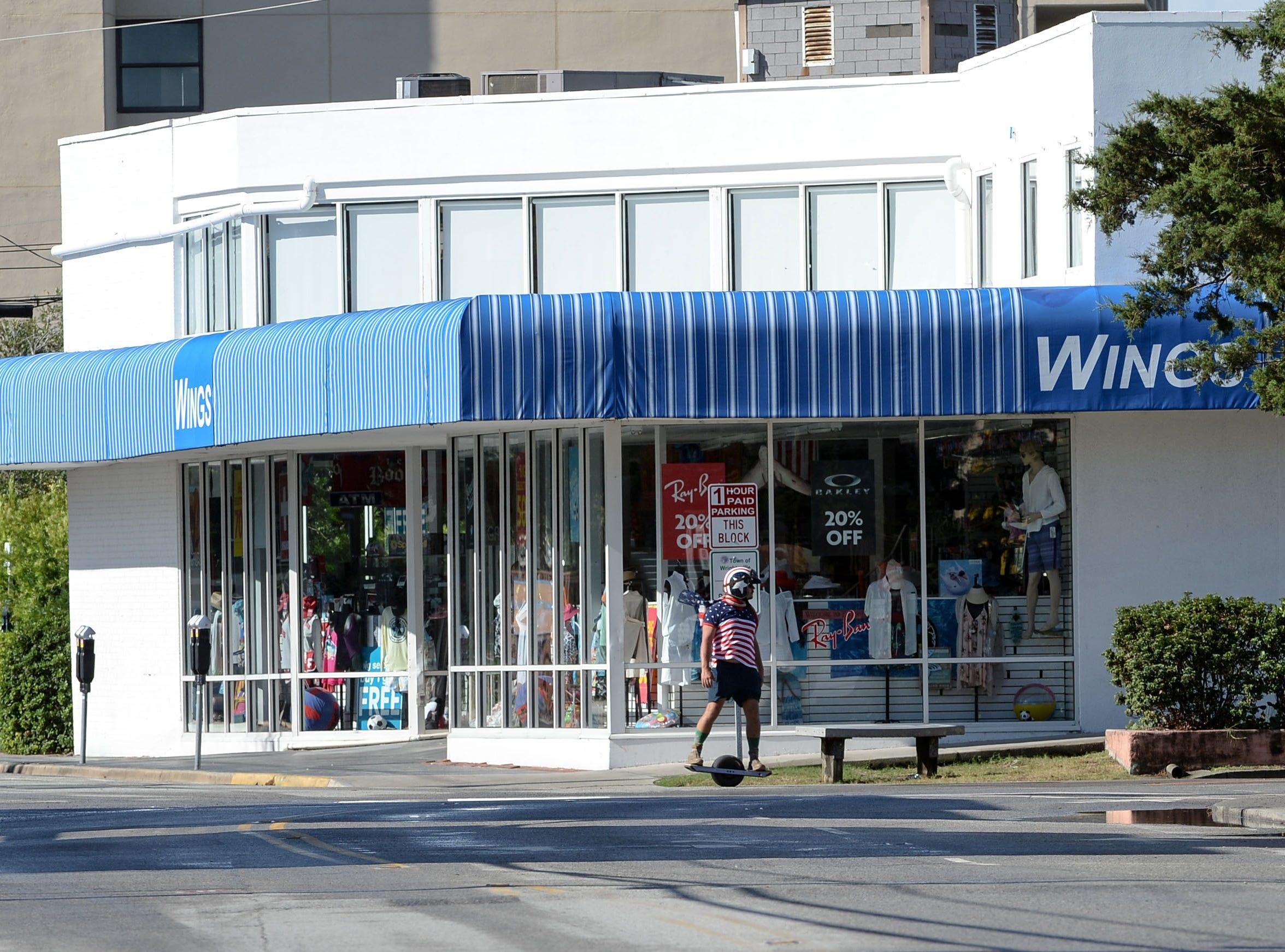 A man skates near a Wing's store at Wrigtsville Beach in Wilmington, North Carolina on Wednesday, September 12, 2018.  (Ken Ruinard / Greenville News / Gannett USA Today Network / 2018 )