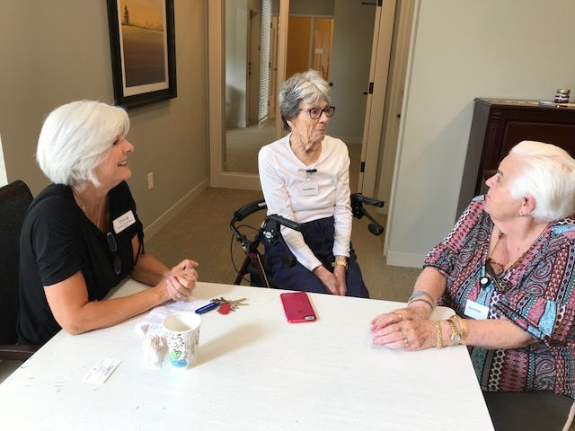 Thrive at Prince Creek president Jacque Richardson chats with residents Jean Miller and Joan Pardo about their trek from Murrells Inlet to Greer.