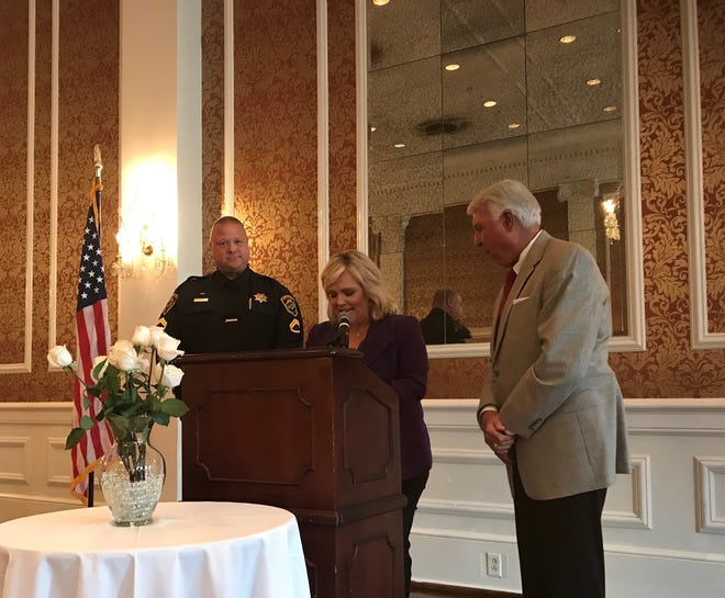 Master Deputy Conley Jumper (left) Accepts Russ Sorrow Award from Amy Wood (middle) and Sheriff Johnny Mack Brown (right)