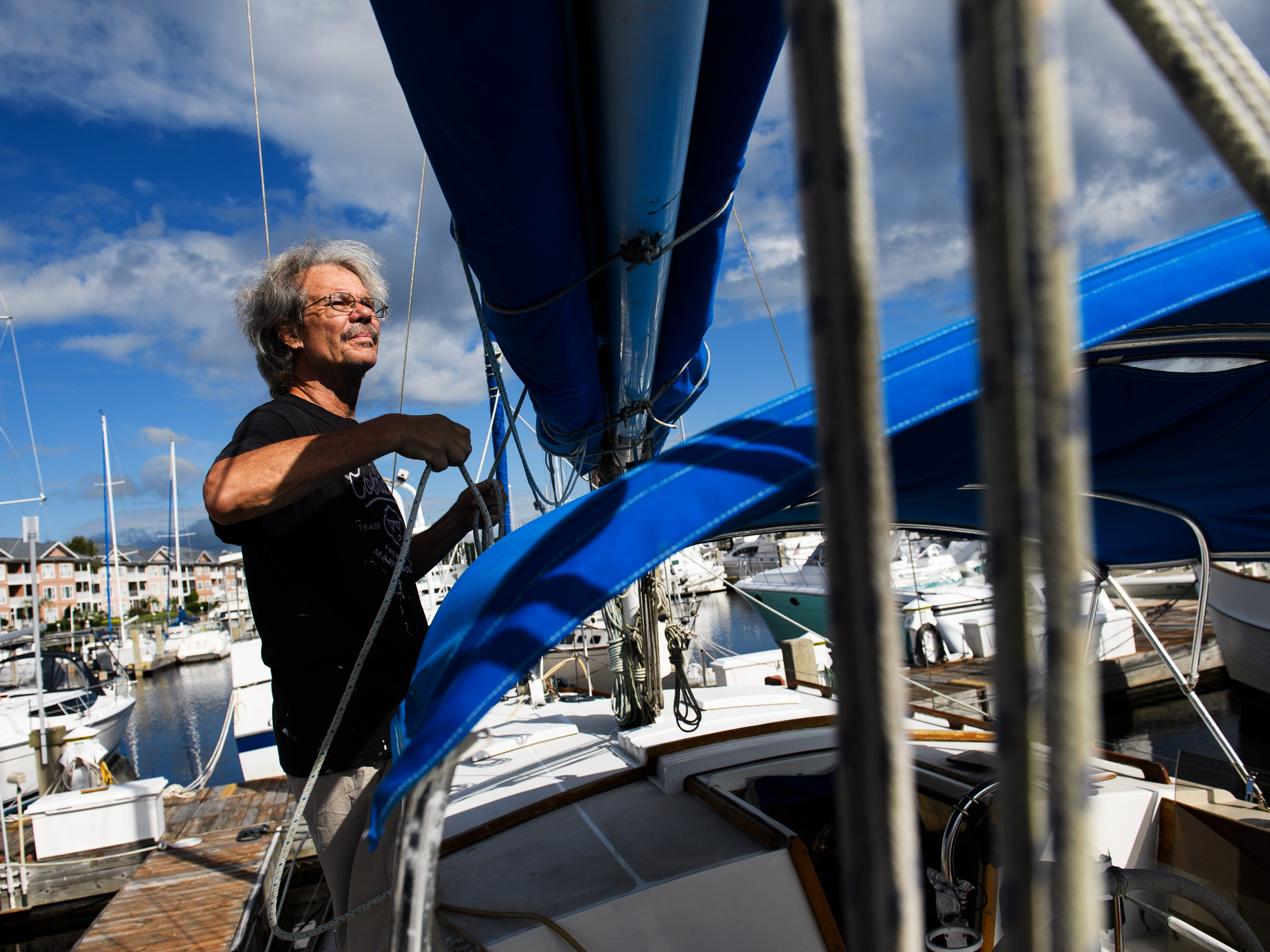 Steve Forsythe ties down the sails of his boat as he prepares for Hurricane Florence on Wednesday, Sept. 12, 2018 at Lightkeepers Marina in North Myrtle Beach. Steve and his wife Jill will be going back home to Akron, Ohio after they're done securing their boat.
