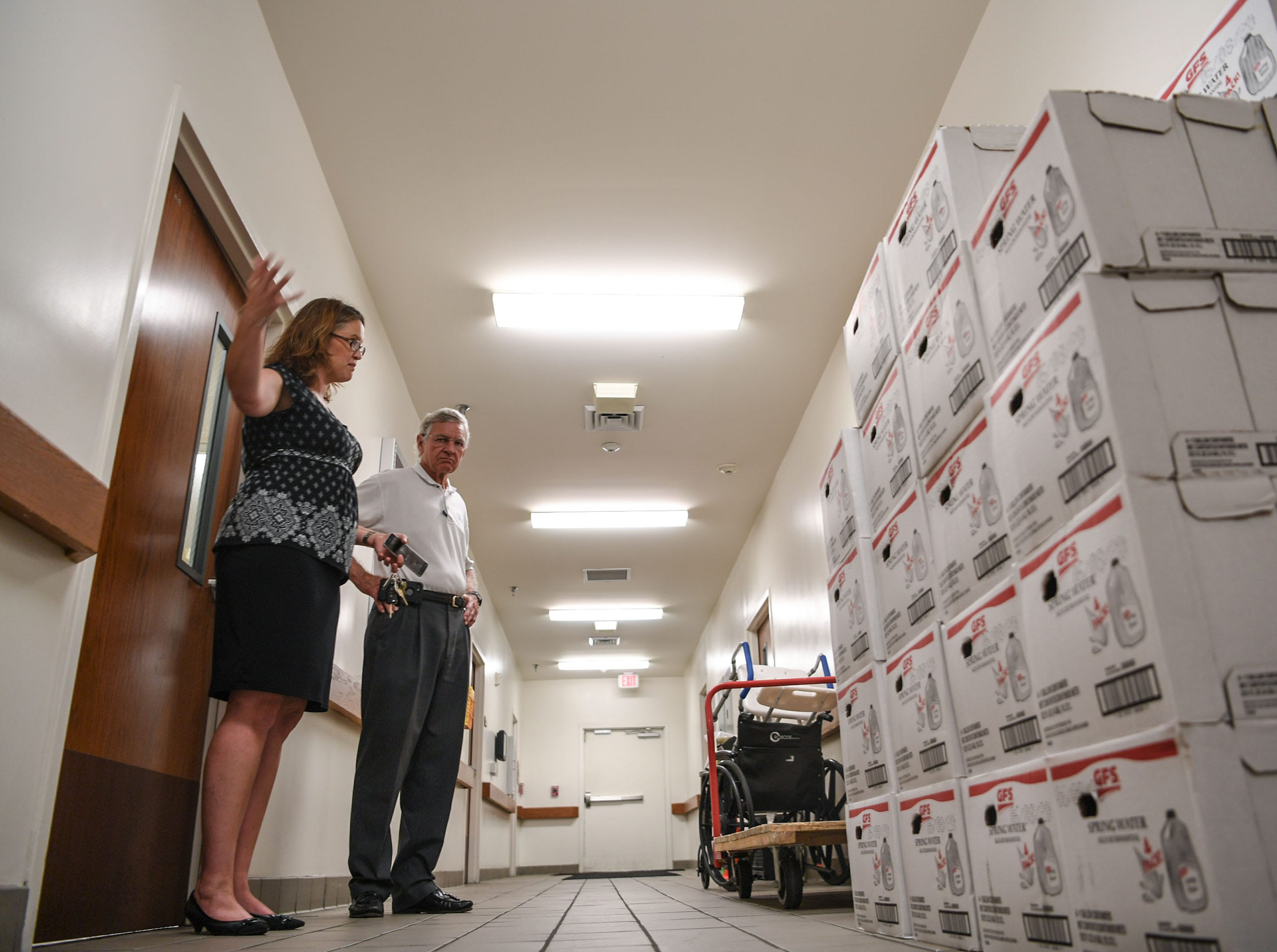 Bonnie Skobel, left, an administrator at the Trinity Grove Nursing Home in Wilmington, North Carolina, looks at supplies of water and food with Director John Frye, right, on Wednesday. Hurricane Florence is expected to reach Wilmington on Thursday night and Skobel said the home is ready for it. (Ken Ruinard / Greenville News / Gannett USA Today Network / 2018 )