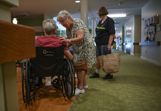 Kay Torrens, right, stands with her husband Leo Torrens before leaving him at the Trinity Grove Nursing Home in Wilmington, North Carolina on Wednesday. Hurricane Florence is expected to reach Wilmington on Thursday night. (Ken Ruinard / Greenville News / Gannett USA Today Network / 2018 )
