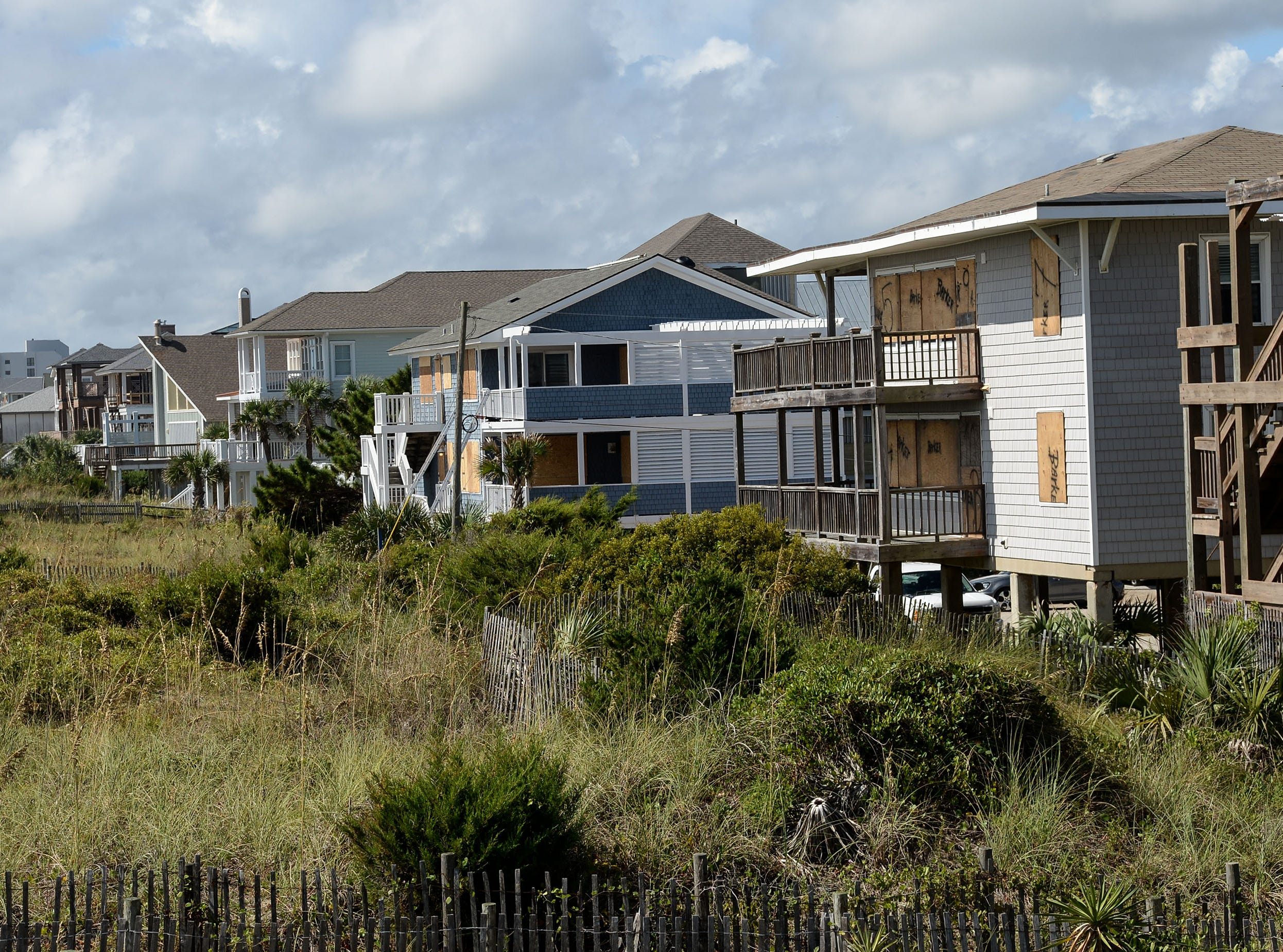 Houses on the shore are boarded up at Wrigtsville Beach in Wilmington, North Carolina on Wednesday, September 12, 2018.  (Ken Ruinard / Greenville News / Gannett USA Today Network / 2018 )