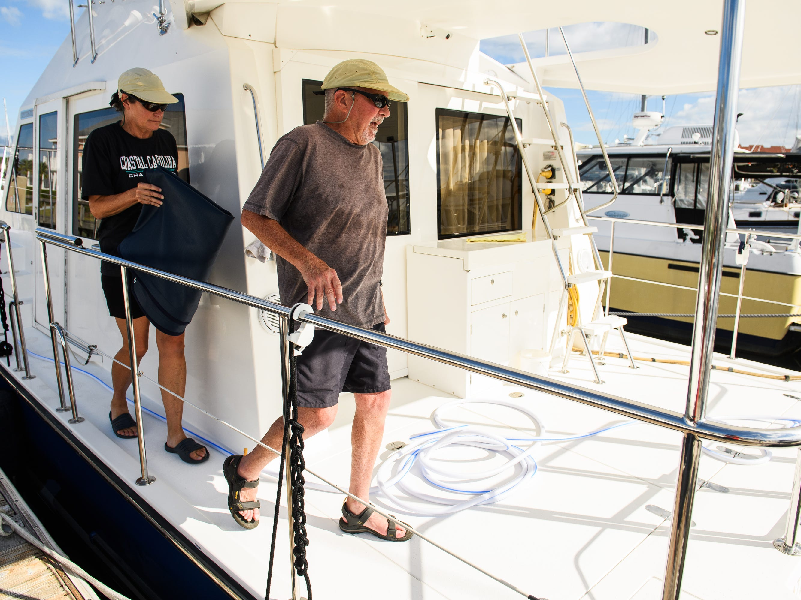 Eric an Barbara Coates prepare their boat for Hurricane Florence at the Lightkeepers Marina in North Myrtle Beach on Wednesday, Sept. 12, 2018. The couple said they will be staying for the hurricane and will be monitoring the docks from their nearby condo.