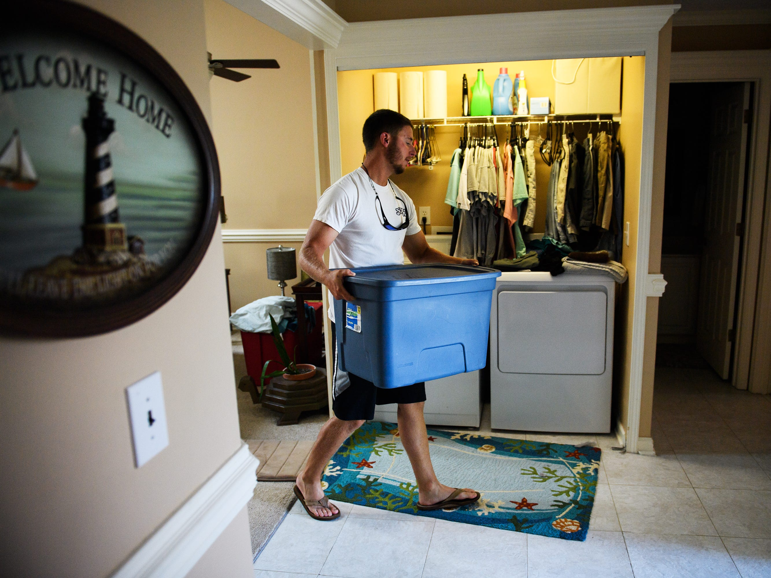 Jesse Prince packs up necessities as he prepares to evacuate his home in North Myrtle Beach to Florida in anticipation of Hurricane Florence on Wednesday, Sept. 12, 2018.