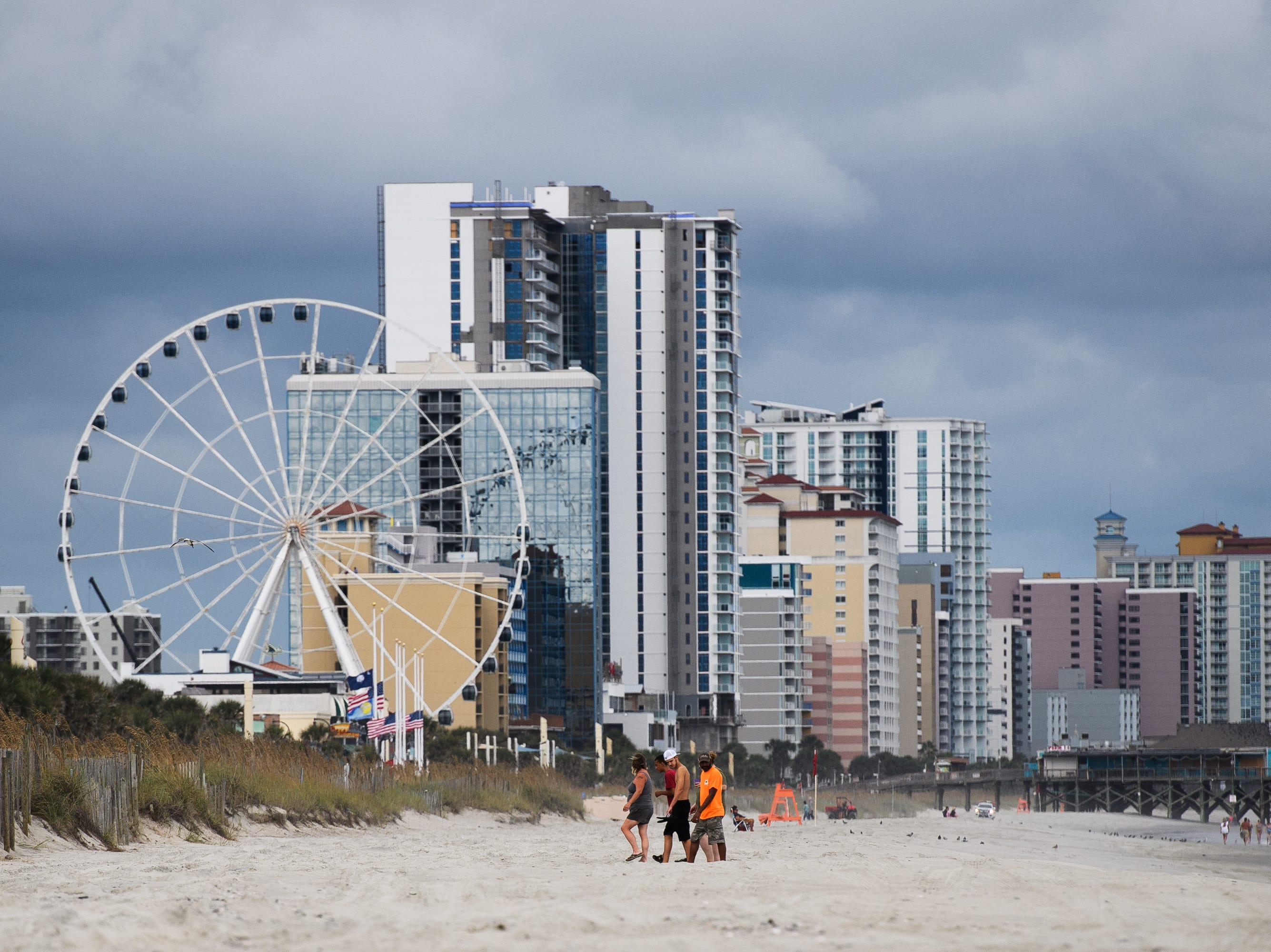 Myrtle Beach residents who stayed in the city the day of the mandatory evacuation enjoy a nearly empty beach days before Hurricane Florence's arrival on Tuesday, Sept. 11, 2018.