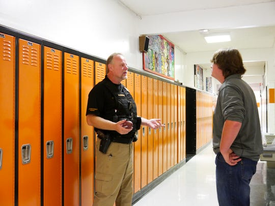 Lt. Bob Rosipal, left, takes a moment to speak with Centerville School senior Brock Landon about job opportunities in the Cascade County Sheriff's Office Wednesday, Sept. 12, 2018.