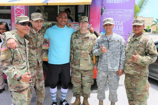 Soldiers, from the Guam Army National Guard's 1st-294th Infantry Regiment's Charlie Company pose for a photo with Ray Chargualaf, third from left, owner of Fat Boy Slim Food Truck on Wednesday, September 12, in Hagatna. Chargualaf donated food to the soldiers to show his appreciation for the hard work they were doing for the community as they conducted traffic control at the intersection of the boat basin in Hagatna. Pictured from left to right: Private second Class Matthew Ulloa; Private first Class Greg Mafnas; Ray Chargualaf; Chaplain (Capt.) Cody Coolidge; Private First Class Jeric Aquino; and Specialist Stephen Tedtaotao.