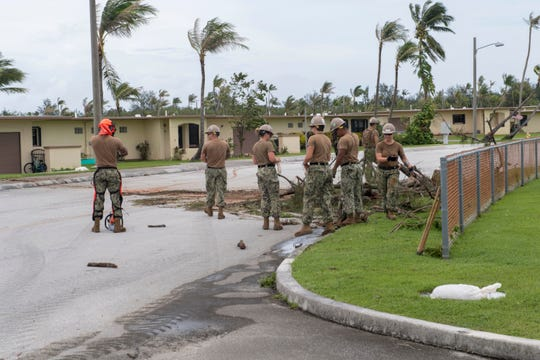 Sailors attached to Naval Mobile Construction Battalion 1, Det. Guam, remove debris on Naval Base Guam following Typhoon Mangkhut Sept. 11, 2018. Servicemembers from Indo-Pacific Command are also providing Department of Defense support to the Federal Emergency Management Agency, and working with Guam and Commonwealth of the Northern Marianas' civil and local officials