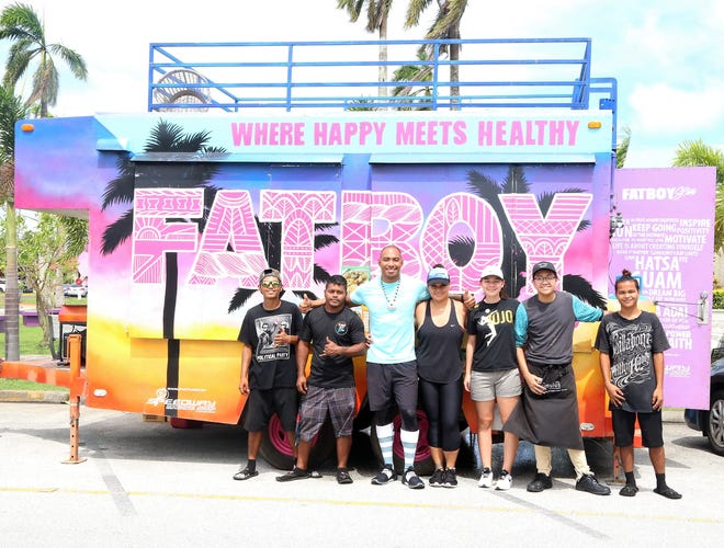 Ray and Deidre Chargualaf, at center, owners of Fat Boy Slim Food Truck, pose for a photo with co-workers, on Sept. 12, in Hagatna, after donating food to Guam Guard Soldiers. Pictured from left: Daryn Duenas, Jesse Aguero, Ray and Deidre Chargualaf, Myriah Reed, Samson Babac and Donavan Duenas.