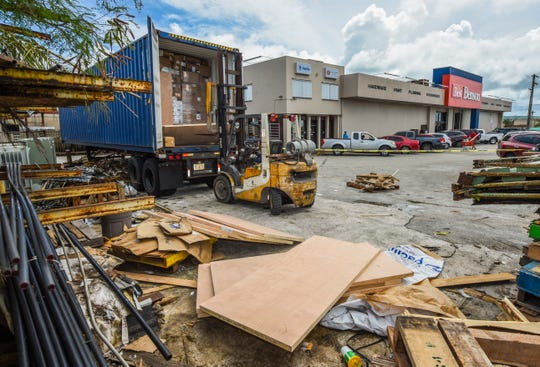 A parked forklift and wooden door panels, can be found at the rear of an opend shipping container marked off with yellow caution tape, after an industrial accident that sent a man to the hospital, was reported at the Benson hardware store in Maite on Wednesday, Spet. 12, 2018.