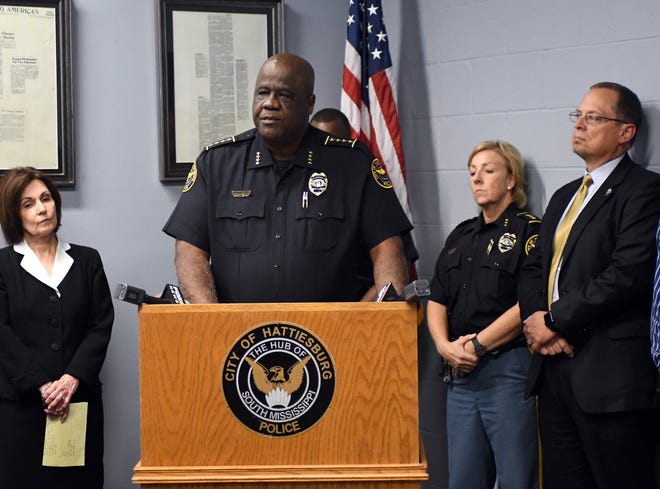 Hattiesburg Police Chief Anthony Parker, center, talks about efforts to stem large-scale drug sales during a press conference after a multi-agency investigation.