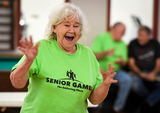 Shirley Bailey reacts to one of her throws as she competes in the Washer Toss at the Henderson Senior Games held in the Gathering Place Wednesday, September 12, 2018.