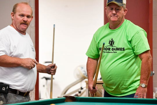 Competing in the Henderson Senior Games 9-Ball pool tournament Patrick Arndell, left, and Billy Haire ponder the next shot Wednesday. Haire got the gold medal and Arndell received the bronze at the tournament held in the Gathering Place, September 12, 2018.