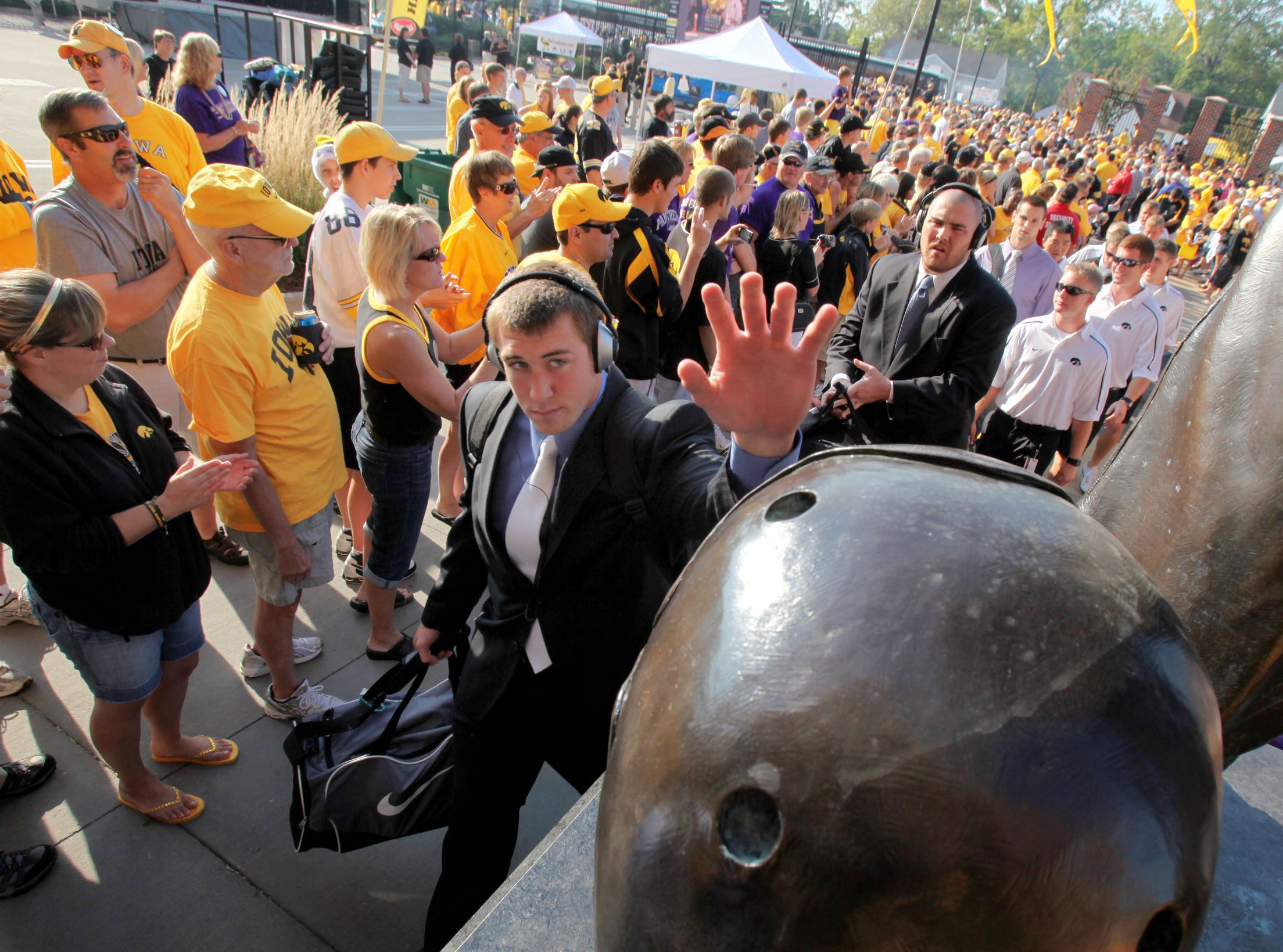 Iowa football players touch the helmet on the Nile Kinnick statue while entering Kinnick Stadium before Iowa's football season opener Sept. 5, 2009 against Northern Iowa in Iowa City.