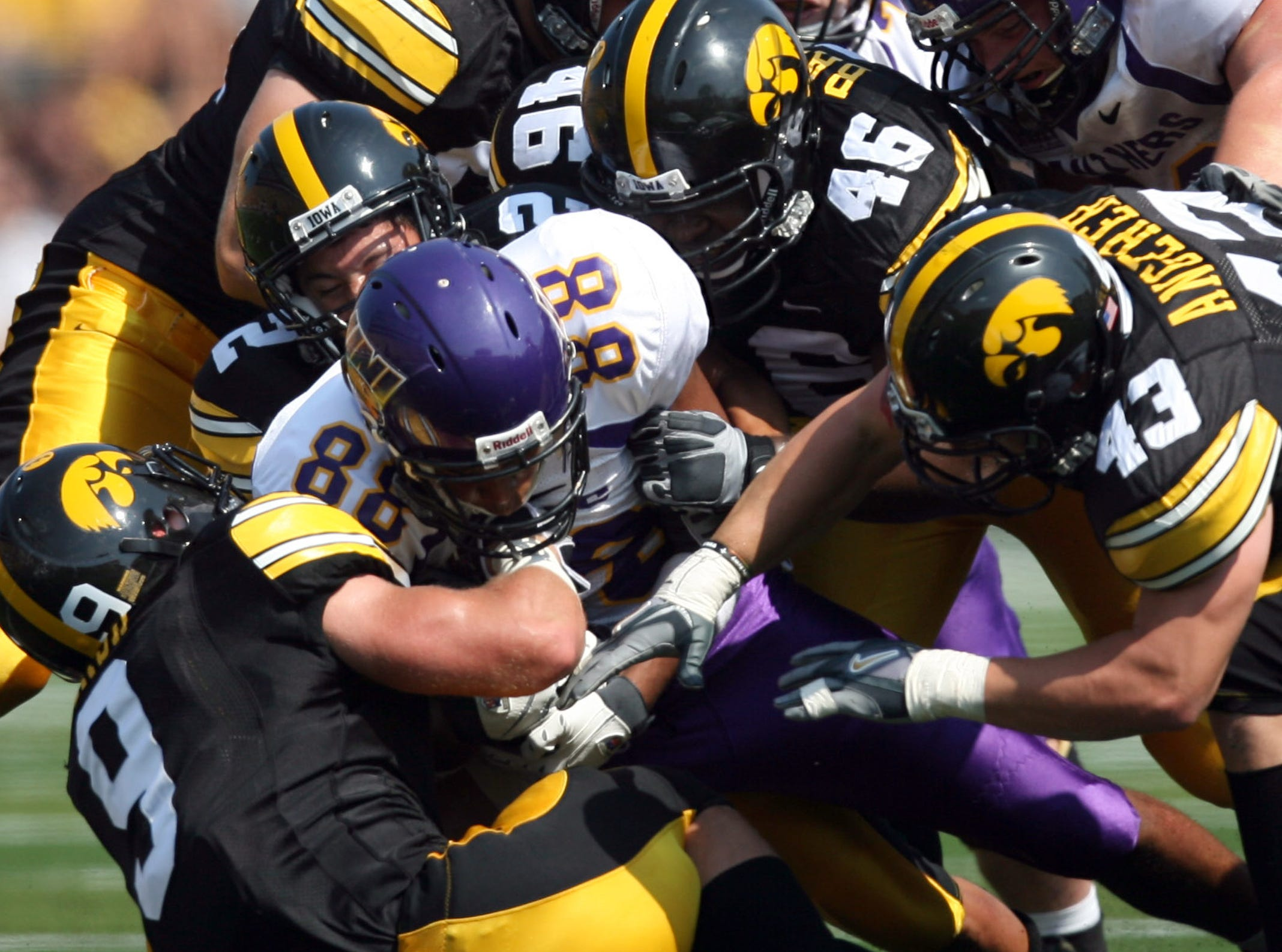A group of Hawkeyes gang tackle Northern Iowa wide receiver Maurice Turner (88) Sept. 5, 2009 in Iowa City.